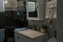 main bath, with second bedroom direct access