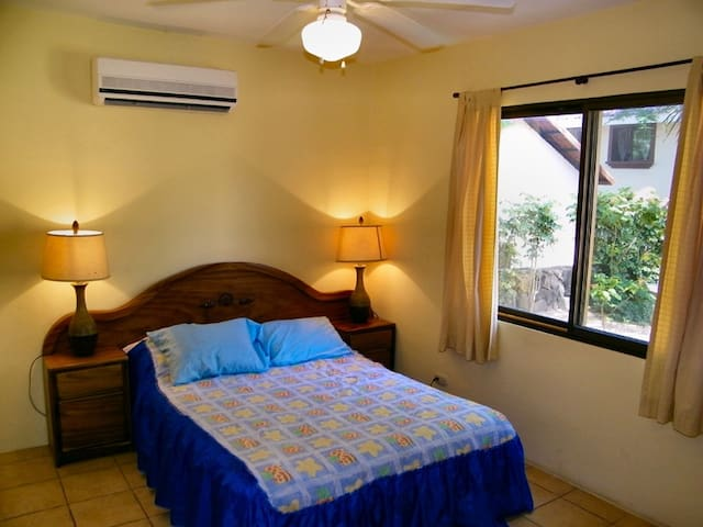 Master bedroom with separate ac and view into the garden.