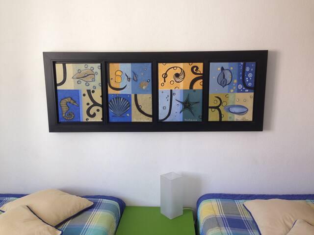 Apartamento decorado com pintura original