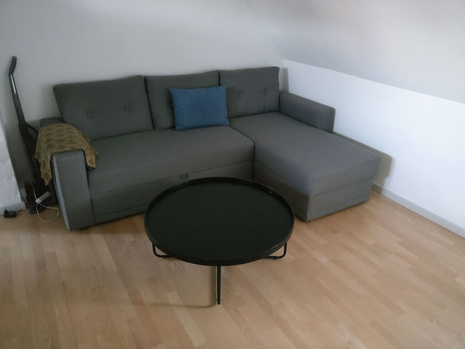Couch area. Containing a sofabed.