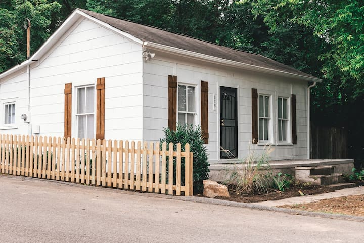 """Quaint and simple house with lots of """"orang-inal"""" character & a big front porch."""