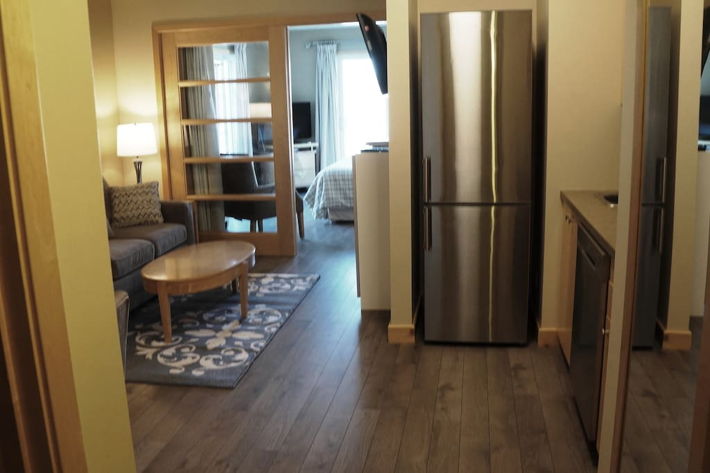 High end stainless steel fridge & dishwasher, two burner cooktop, toaster oven, coffee maker, kettle  & fully equipped kitchen.