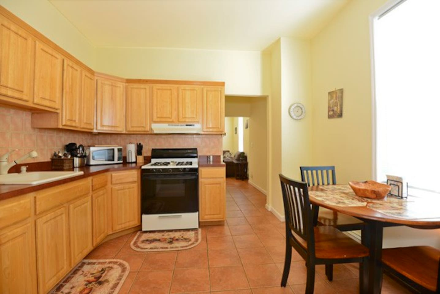 fully-stocked, light and spacious kitchen