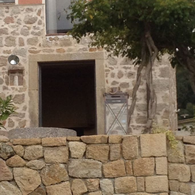 Original stone doors and even one of the original olive press stones