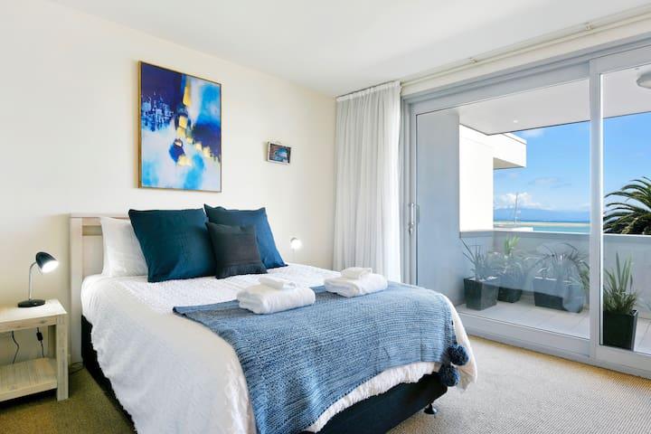 Master bedroom with Queen Bed, sea views, private balcony & ensuite bathroom.