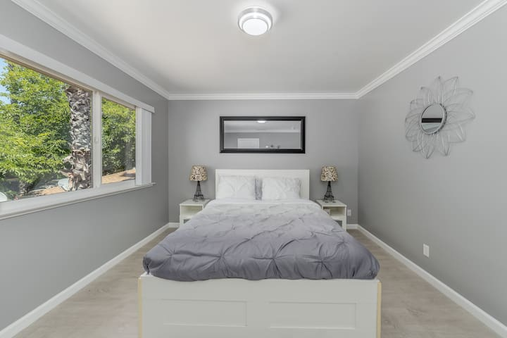 Queen bed with storage space underneath.