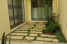 Clean stepping tiles that lead the way from the house to the garden