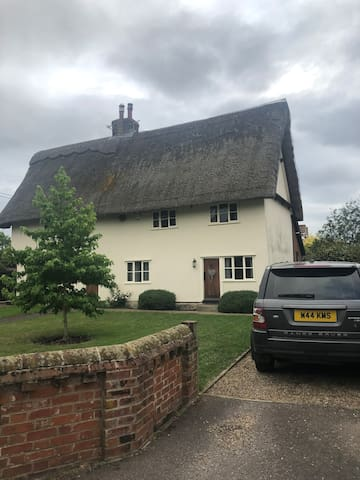 A pretty, thatched character semi detached cottage