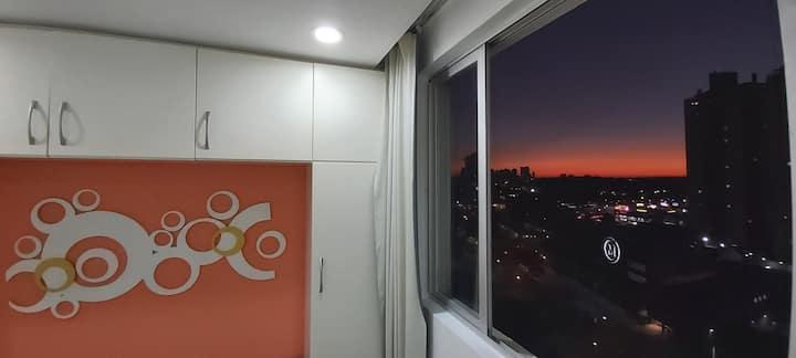Incrível pôr do sol em apartamento aconchegante