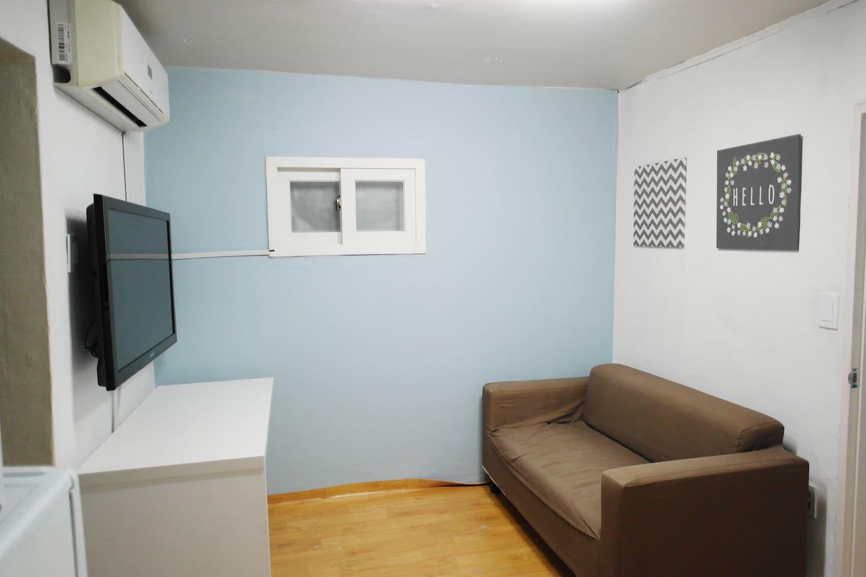 One room studio.  Living room with sofa