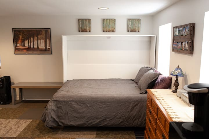 Full-size murphy bed folds in the wall if you want more space to move around during the day!