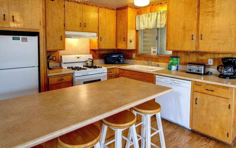 Fully equipped kitchen with full size refrigerator, dishwasher, stove and oven, coffee maker and toaster