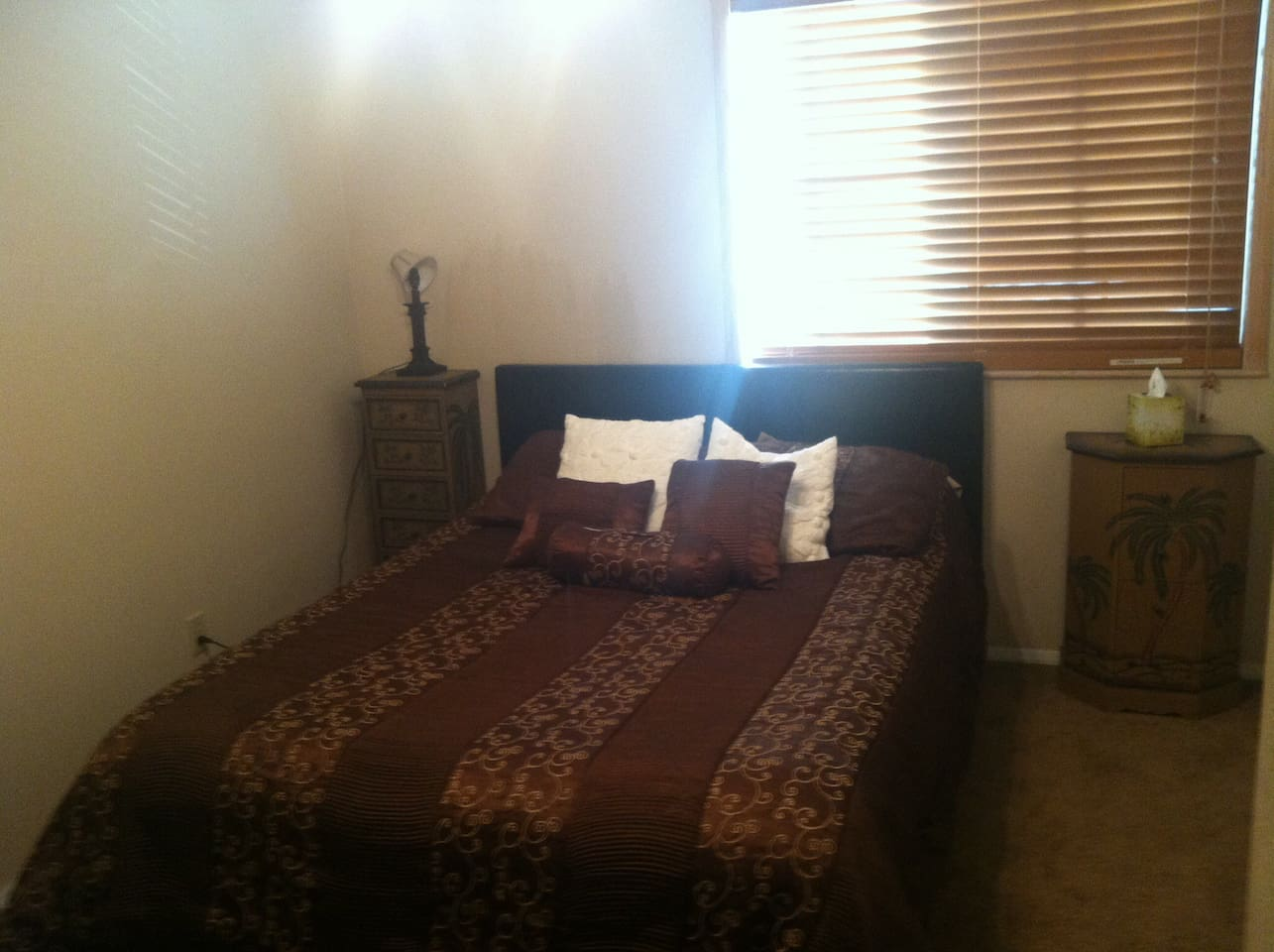 The queen bedroom with a ceiling fan, full closet along with two night stands, tv and DVD player!