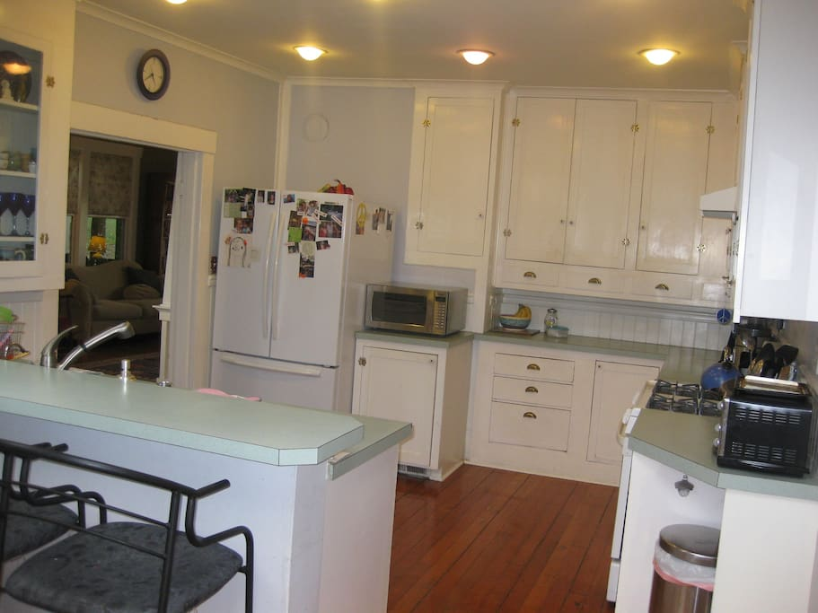 kitchen has skylights and an island with barstools