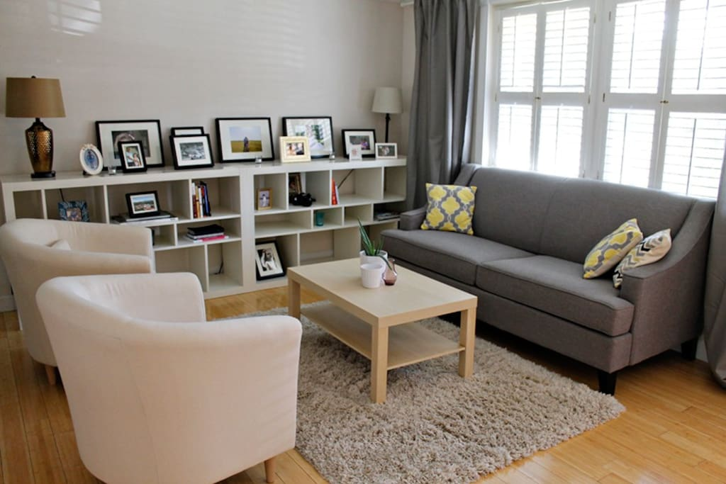 This simple modern living area is the perfect place to relax and enjoy a good book.