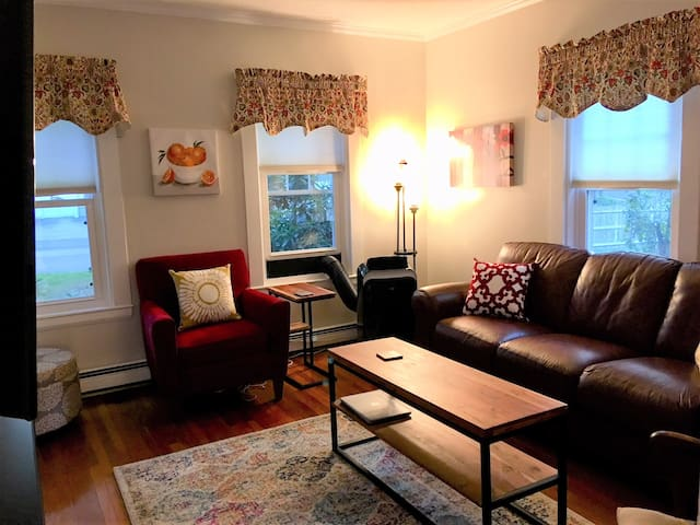 """Cozy living room with 50"""" television with cable and Netflix."""