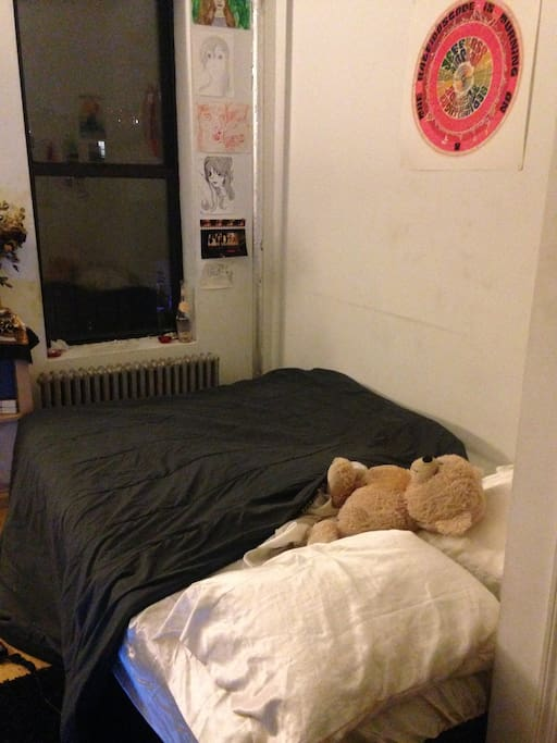 Cozy, spacious bed! Doubles as a futon during the day.