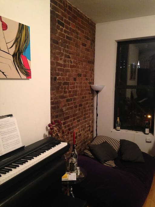 Piano, and huge comfy pillow to hang out on.