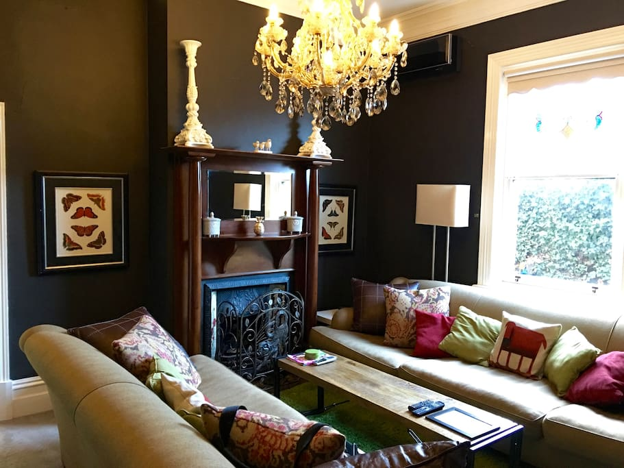 Period sitting room with seating for 10.