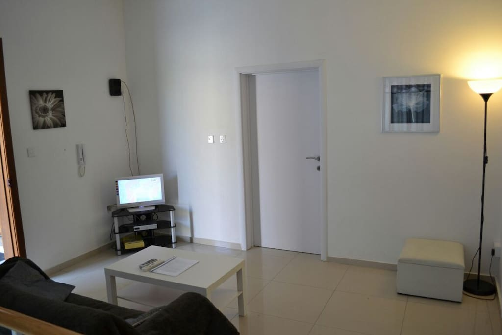 Small but well equipped living room with WiFi,TV with basic service,two seated sofa and own entrance.