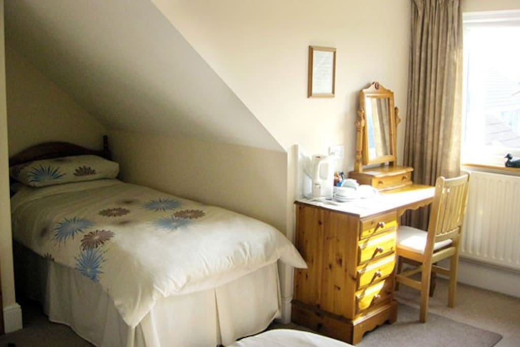 This room sleeps 3, with a double bed and single bed. Perfect for a small family or group of friends.