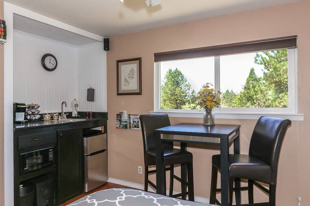 Your dining area/workspace looks down onto the scenic pines and oaks below.