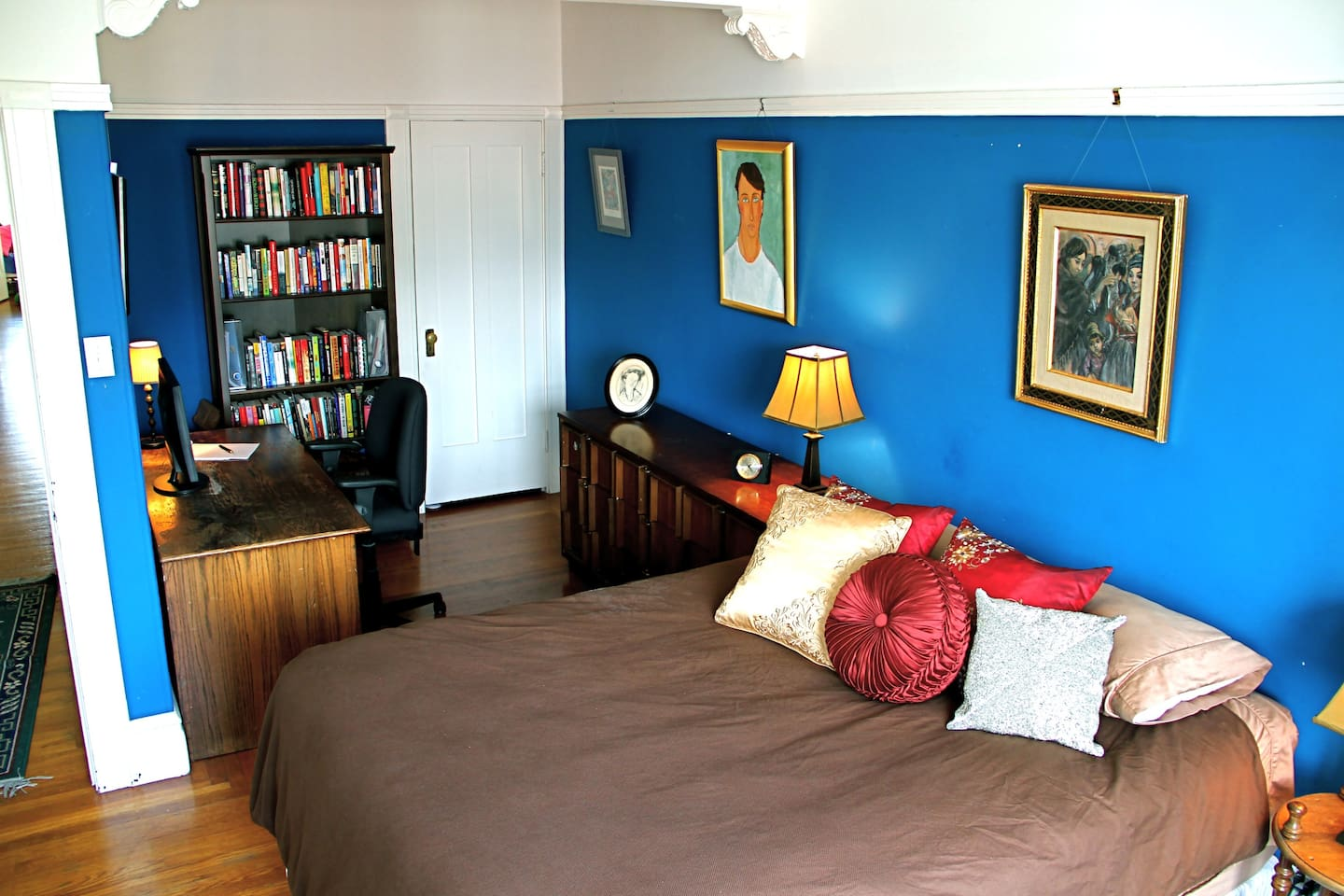 The Cool Blue Room is a stunning relaxing blue surrounding a pillow-topped queen bed.