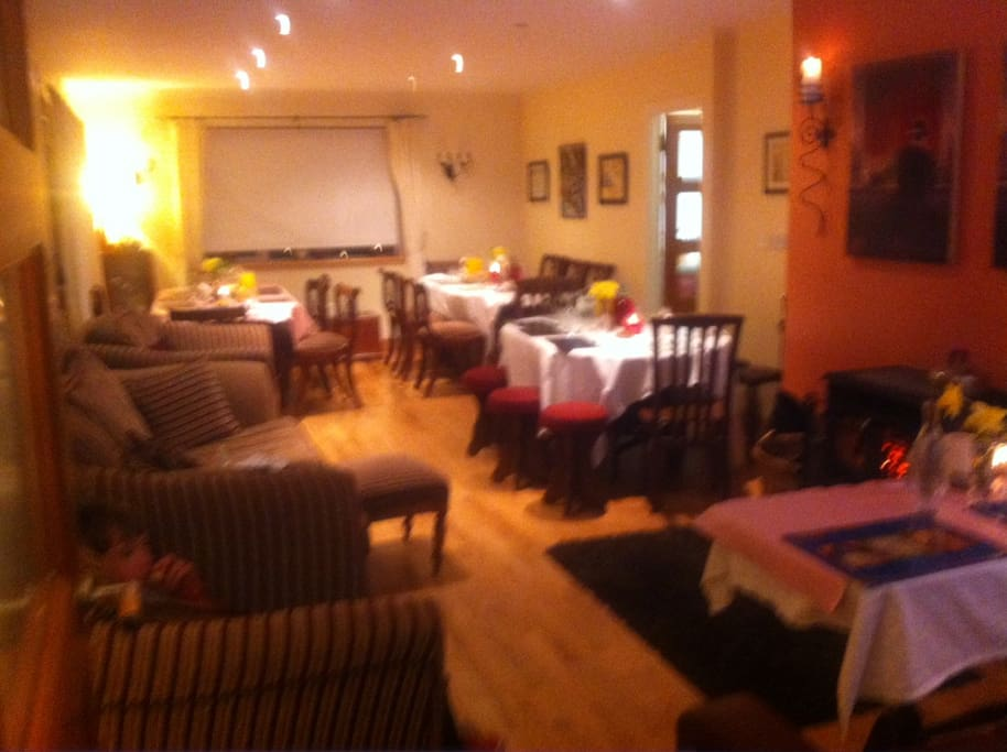 The dining room set for a cycling group of 32