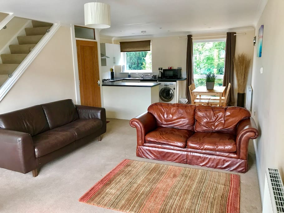 """The bright first floor lounge and open plan kitchen /diner, leather sofas and 49"""" 4K tv"""