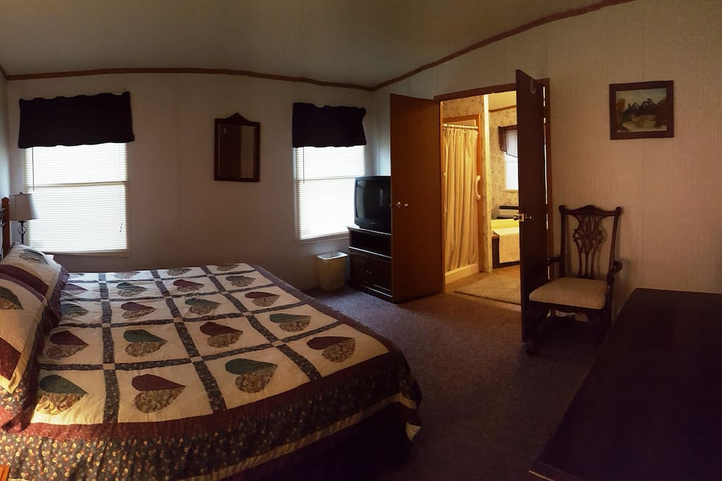 Master Bedroom with King Bed and master bath.