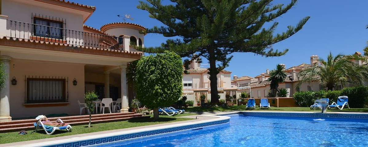 Communal pool with ample sun beds and access to the beach...