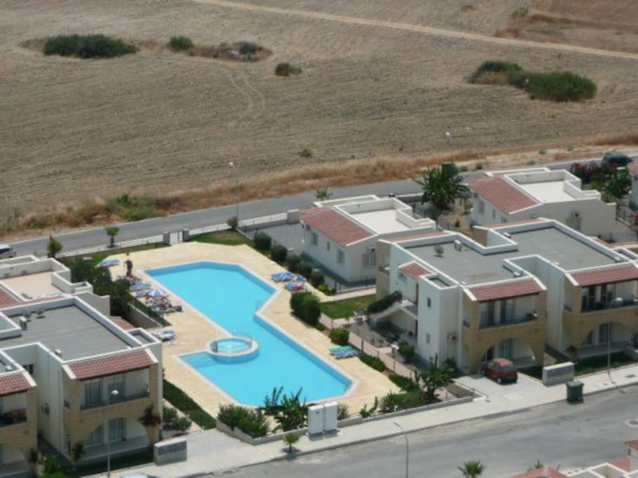 Ariel view of the pool apartment ground floor to the right