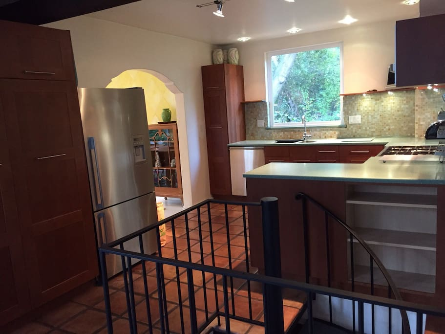 Kitchen with view to Dining room and spiral staircase to downstairs living quarters