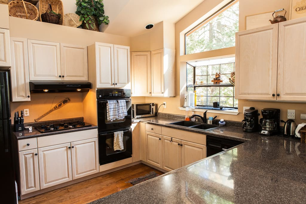 Large kitchen with plenty of counter space for big meals or group cooking. Kitchen is equipped with all necessary utensils and such. Dual oven, 4-top gas burners, and a dishwasher for easy clean up.