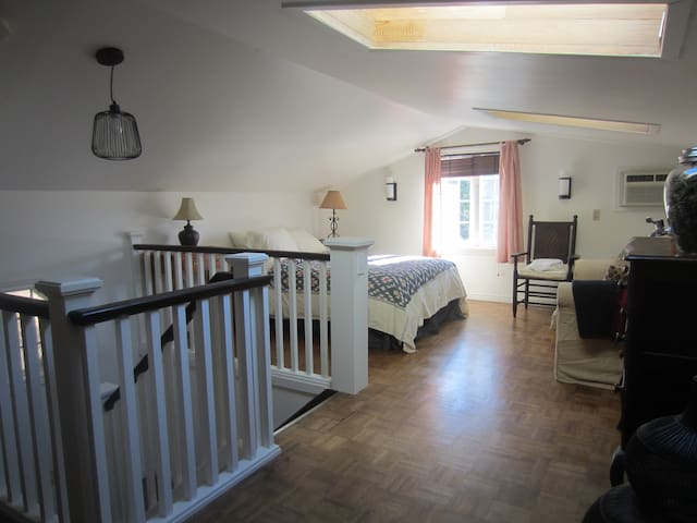 loft bedroom, bright and spacious with skylights, and air conditioning and double bed