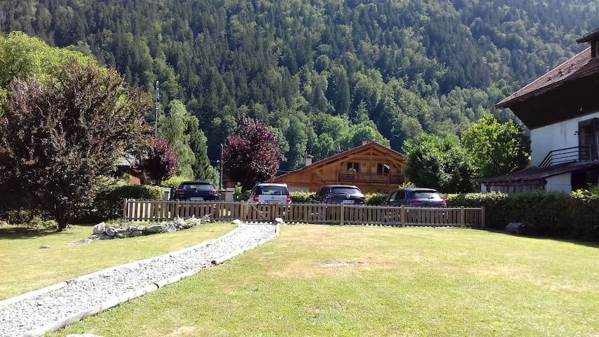 Looking from Chalet Nicole which is set back from the road with a large fenced garden and ample parking for 4- 6 cars.
