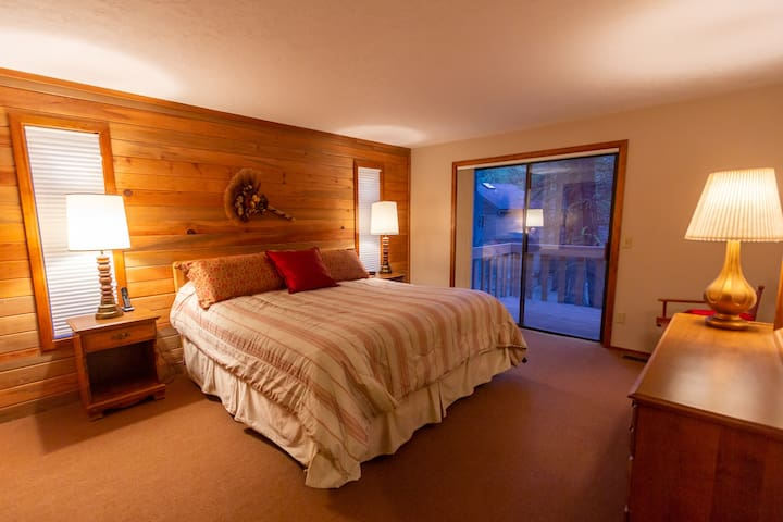 Master bedroom with king bed and private balcony.