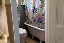 """Charming bathroom meets all the essentials but is extremely small - think """"airplane bathroom small""""."""