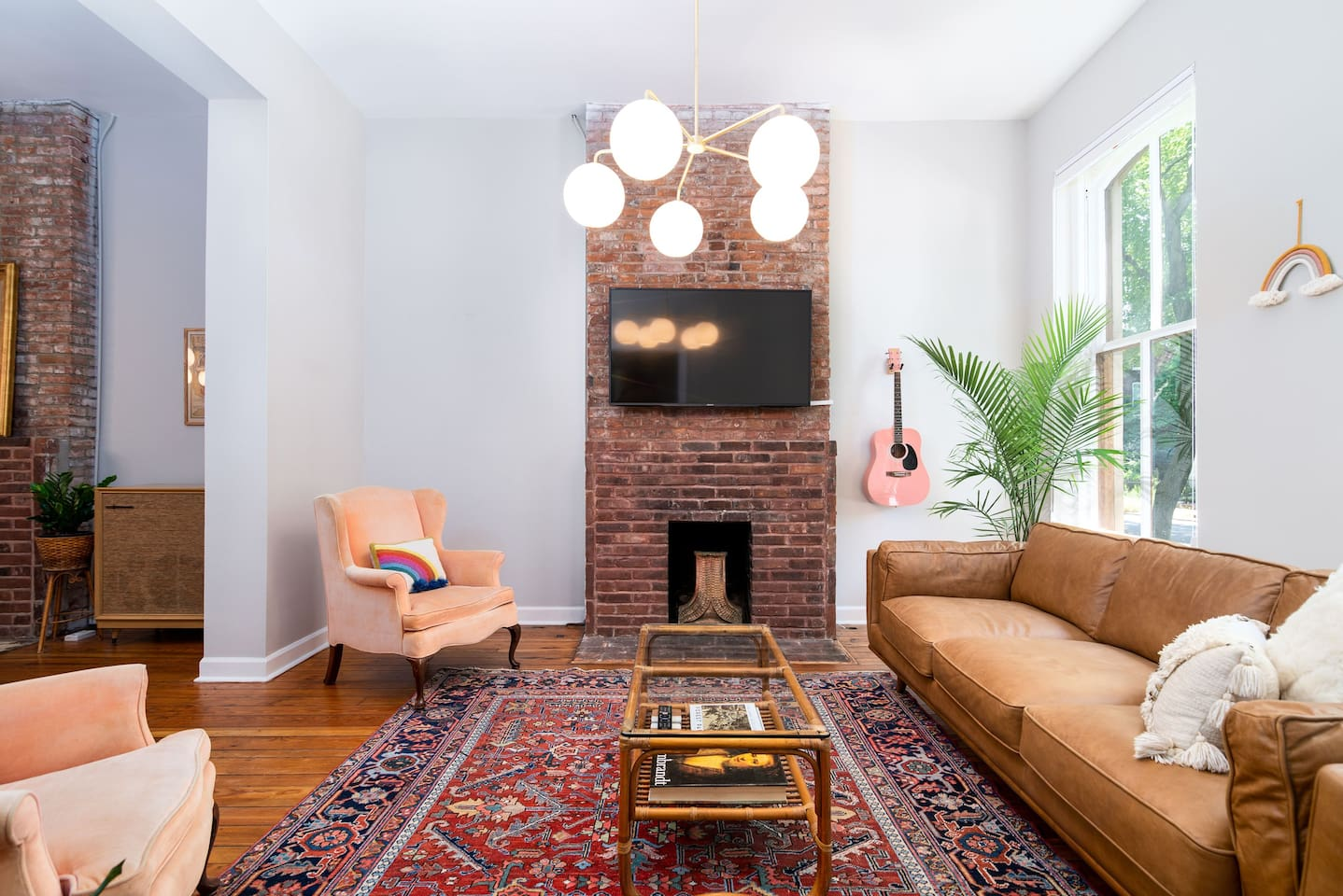 Whether you are watching tv, serenading your friends with the guitar, or sitting around catching up, the living room is the perfect place to gather with friends and family alike.