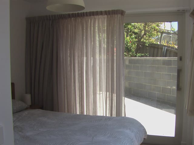 The bedroom opens out onto a courtyard