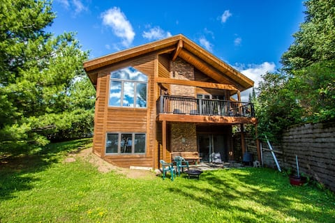 Devil Track 219 is a beautiful, modern home located on the shores of Devil Track Lake