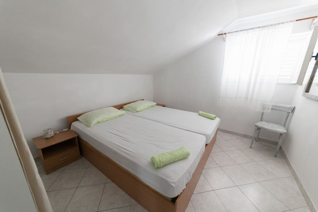 upper apartment double bed bedroom