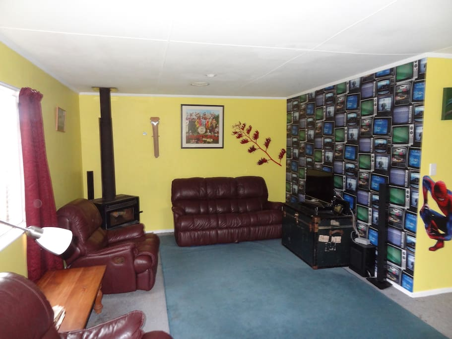 The lounge. Fireplace and telly