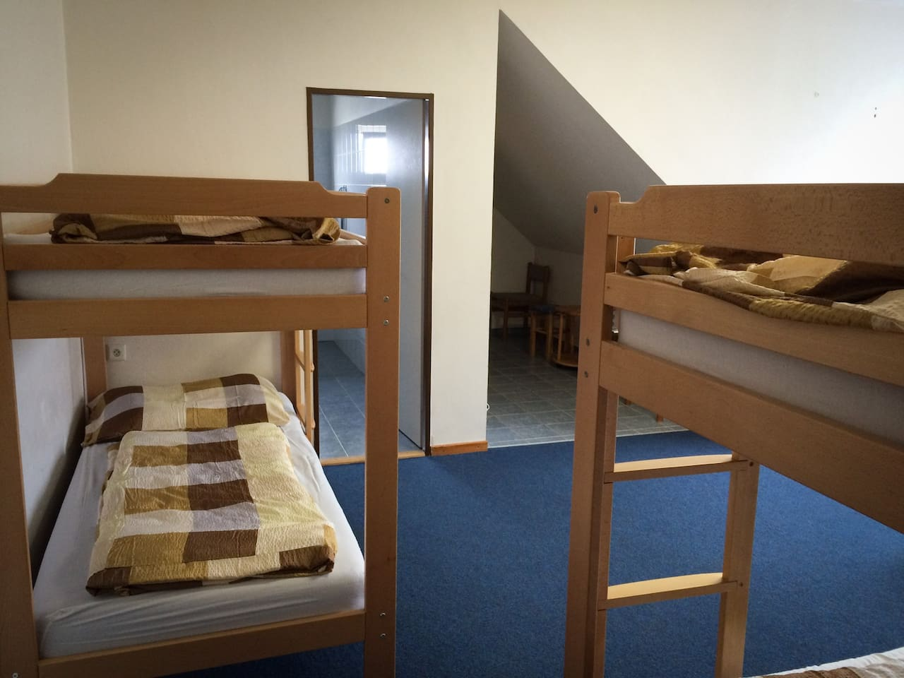 Two bunk beds and a double bed, total of six beds.