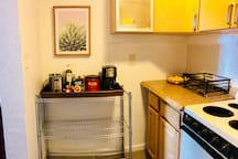 Kitchenette includes: Coffee Bar, Stove/Oven, Sink, Mini Fridge, Dishes & Cookware