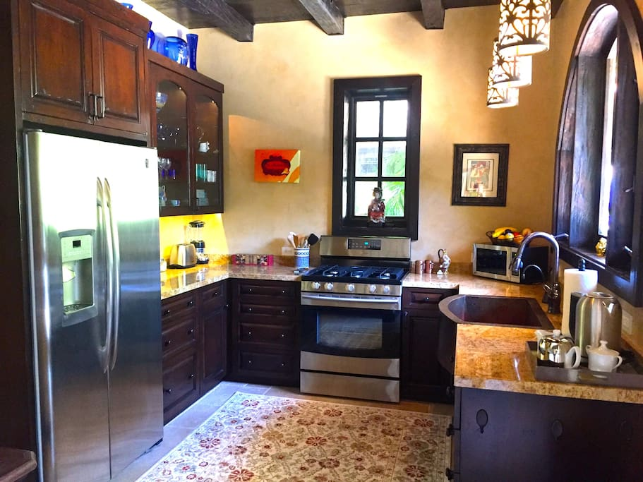 The stocked kitchen with a view to the pool.
