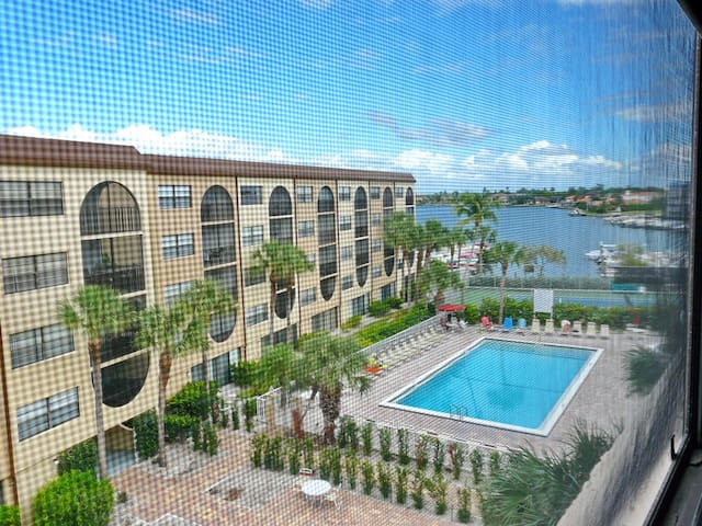 Airy condo in 13-acre waterfront community w/ pools & tennis courts