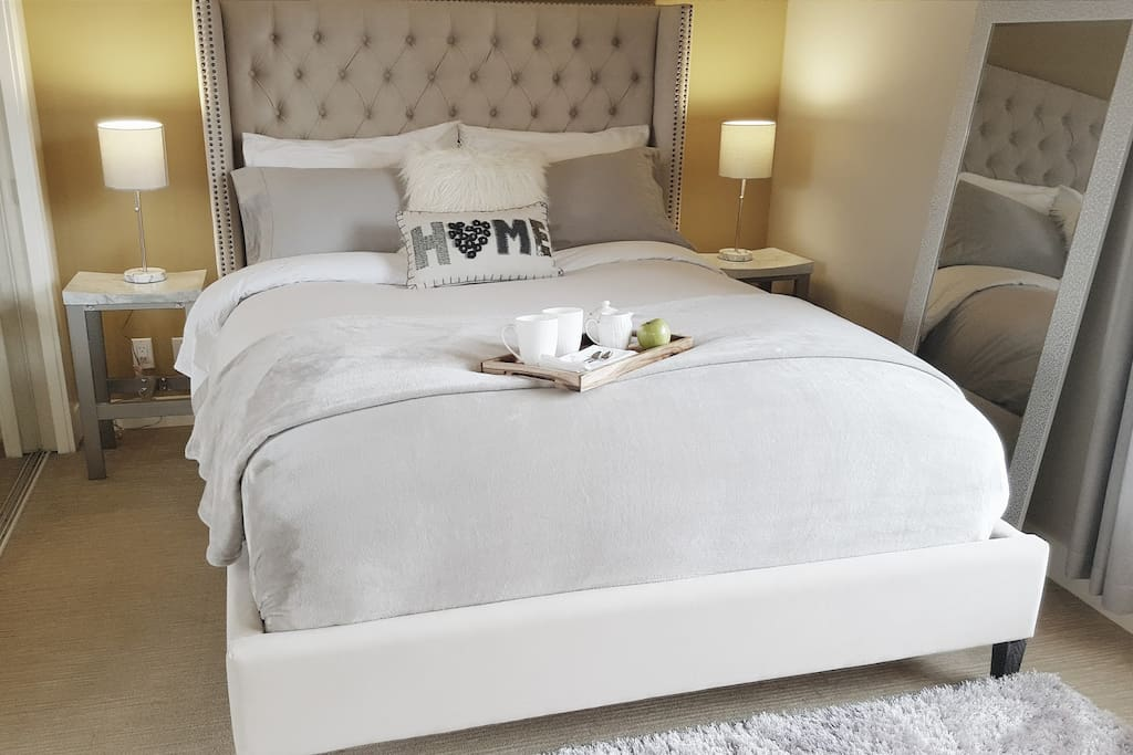 Bedroom is highend comfort from the gorgeous Muse & Merchant velvet upholstered bed, crisp and cool GlucksteinHome percale sheets, memoryfoam Beautyrest mattress, hypoallergenic featherbed topper, down pillows and duvet.