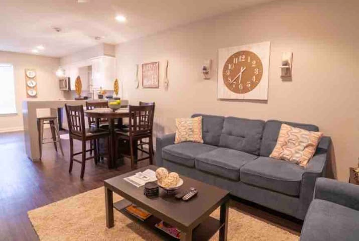 living room has a open concert.  the minute you walk in you can see the overlay of the kitchen dinning room table as well as a fully equipped kitchen.