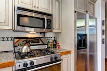 Find stainless appliances, granite counters and antique white cabinets in the kitchen.